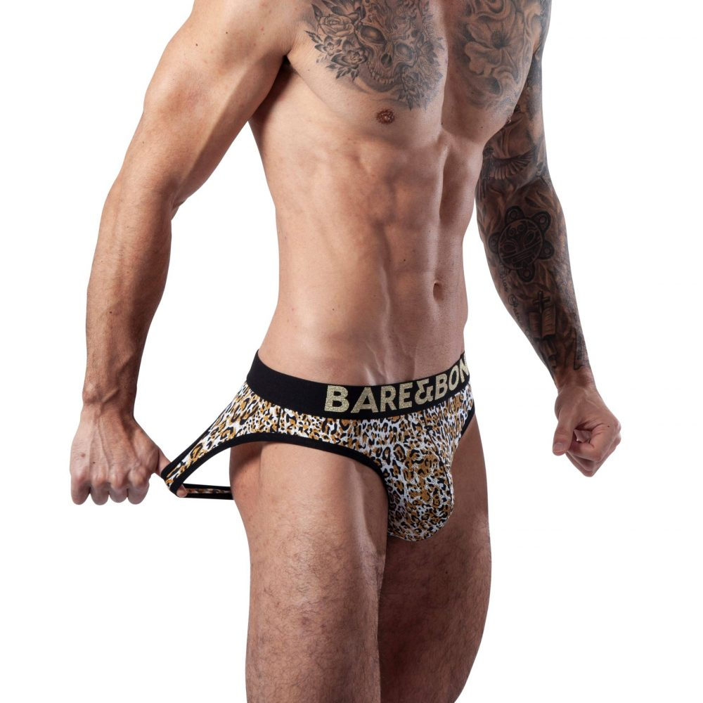 Playful Man wearing Mens Leopard Print Backless Briefs by Bare&Bone from the left